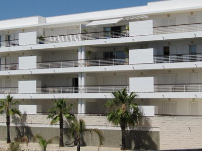 View to apartment, top floor centre, balcony with sun awning