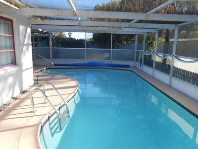 Photo for Quiet and private screened in pool home 2br/2 bath, hot tub - fully equipped