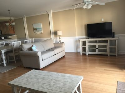 """2 couches, 1 chair, 50"""" television with BluRay player"""