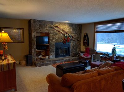 Living room with flat panel TV and wood-burning fireplace
