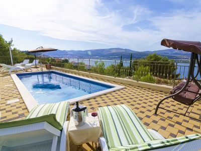 Photo for This 5-bedroom villa for up to 10 guests is located in Arbanija and has a private swimming pool, air