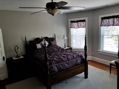 Mater bedroom with a high queen bed