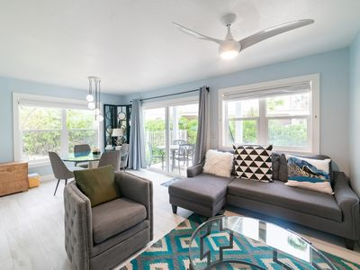 Photo for Oceanside Beach Condo - right on Seven Mile Beach