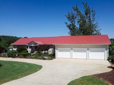 Photo for PEACEFUL LAKEFRONT HOME, 6  BRMS, 3 BA, HOT TUB, HOME THEATRE ROOM, FIRE PIT