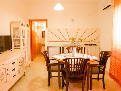 Photo for Alghero - Holiday apartment a few meters from the beach - with terrace