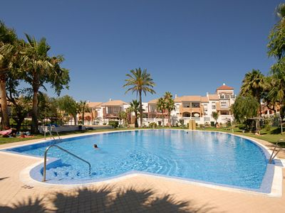 Photo for Air-Conditioned Apartment Close to Beach with Terrace, Pool, Garden & Wi-Fi; Parking Available