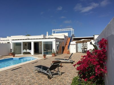 Photo for Spacious and modern villa, private heated pool and sunny terraces.