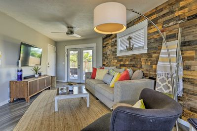 Step inside and settle into the living room with a wood accent wall.