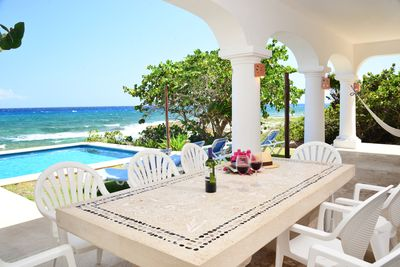 covered terrace with table, chairs, chaise lounges and hammock