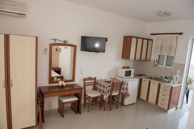 kitchenette fully equipped, table for 2 persons, flat screen tv