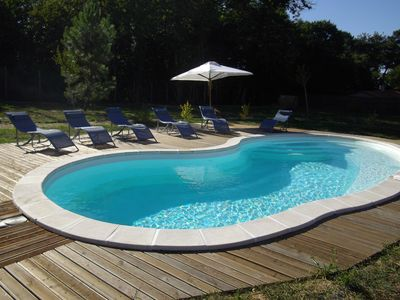 Photo for Magnificent longère of 240m ², done up in comfortable lodging and heated swimming pool