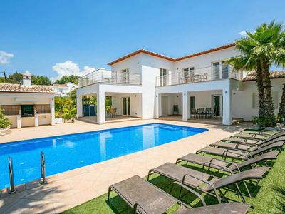 Photo for Modern air-conditioned villa near beach w/ private pool, BBQ & free Wi-Fi