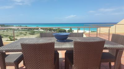 Photo for ELEGANT PENTHOUSE w- PRIVATE ROOFTOP TERRACE ON EAGLE BEACH!