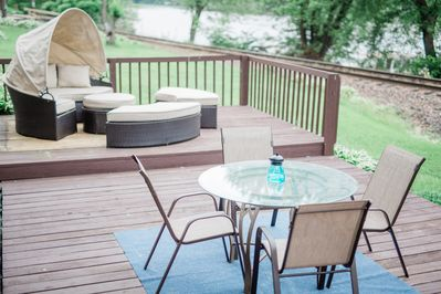 Patio dining and sunbed