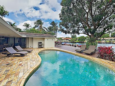 Photo for Luxury Waterfront Living: Private Pool, Boat Dock, Game Room - Near Beach
