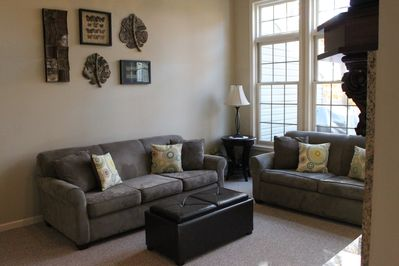 Cozy main living room area w/fireplace, tv and wonderful views!