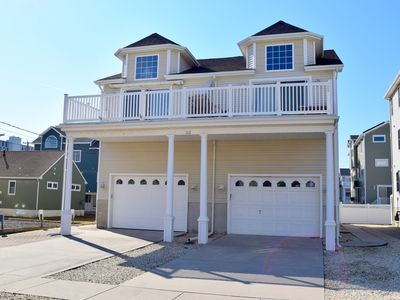 Photo for ONLY 5 to 6 houses from the beach and bay and within walking distance to Promenade