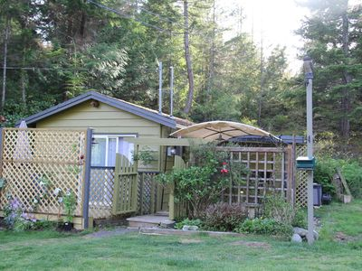 Photo for Charming cabin on picturesque Lily Lake, mere minutes walk to the beach.