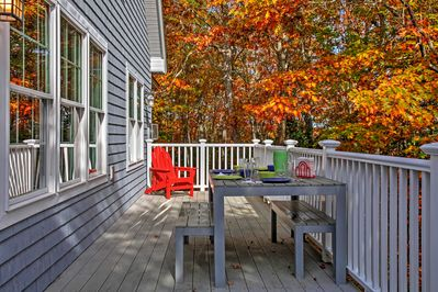 Lounge on the spacious deck overlooking the surrounding woodlands.