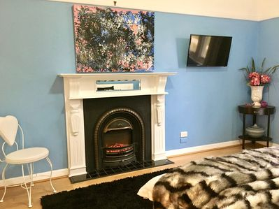 Main queen room with DVD/TV and electric fireplace
