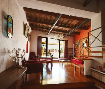 Photo for Trastevere loft, charming top floor with terrace