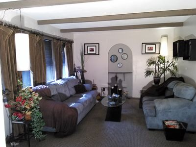 Photo for Cozy split level home near airport, downtown and on busline