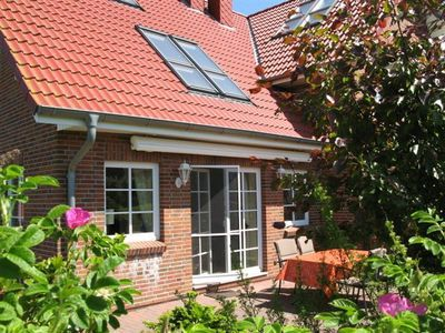 Photo for Idyllic holiday home, 100sqm living space with big garden, 300 mtr to the beach