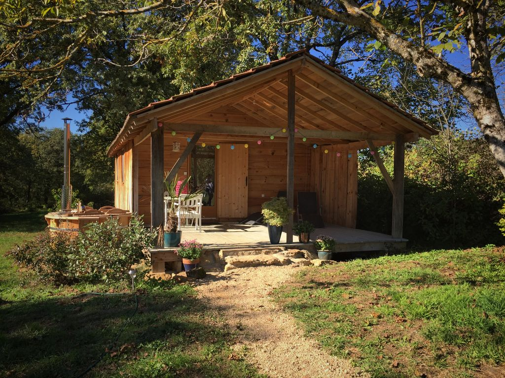 Wooden Cabin with Hot-tub: Pretty cabin in beautiful gardens with ...