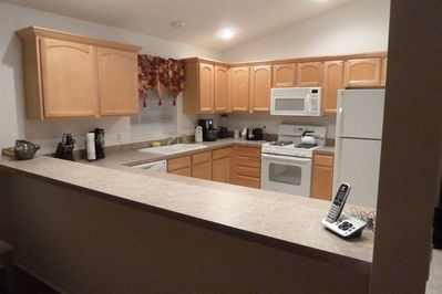 Open kitchen with bar area adjoining