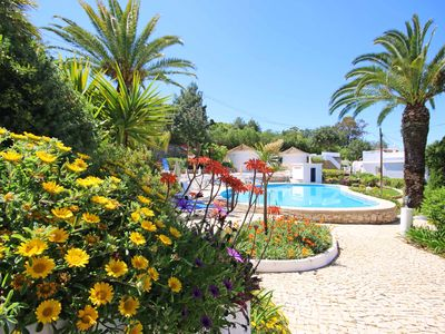 Photo for Charming villa:large sun terrace, pools, a/c, WiFi, near Algarve's best beaches