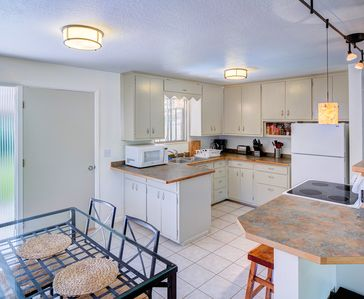Convenient kitchen and dining lead directly to patio/ yard.