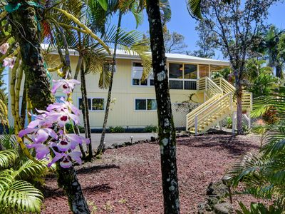 Melemele house is on beautiful Kaloli point.  Enjoy the orchids, & other flowers