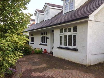 Photo for HOLYWELL, pet friendly, with hot tub in Llandybie, Ref 940760
