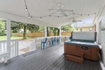 Huge covered deck with bar and hot tub!