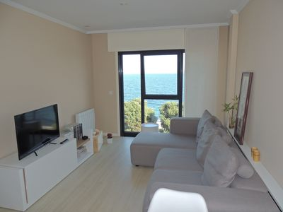 Photo for Romantic apartment with the sea at your feet