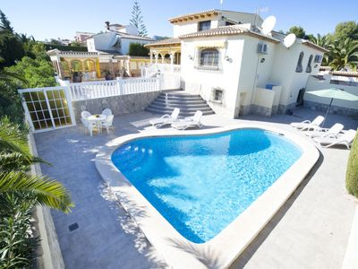 Photo for 4 bedroom Villa, sleeps 9 with Air Con, FREE WiFi and Walk to Beach & Shops