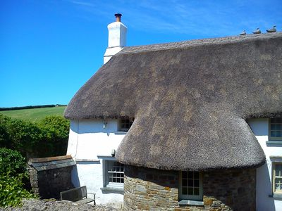 Photo for Thatched Cottage right on the Coastal Path, on a National Trust Working Farm