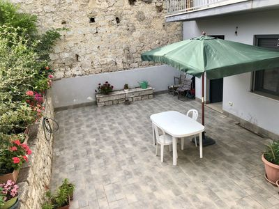 Photo for Comfortable apartment in the center of the village with a magnificent garden for relaxation