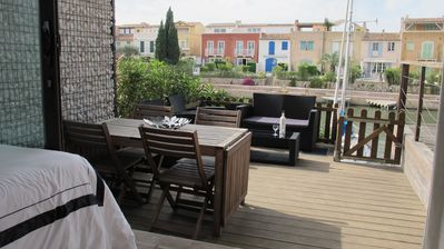 Photo for Cosy large teak terrace in the Gulf of ST Tropez Port Grimaud boats view