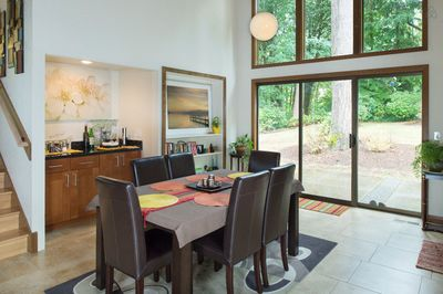 Roomy dining space facing the woodlands
