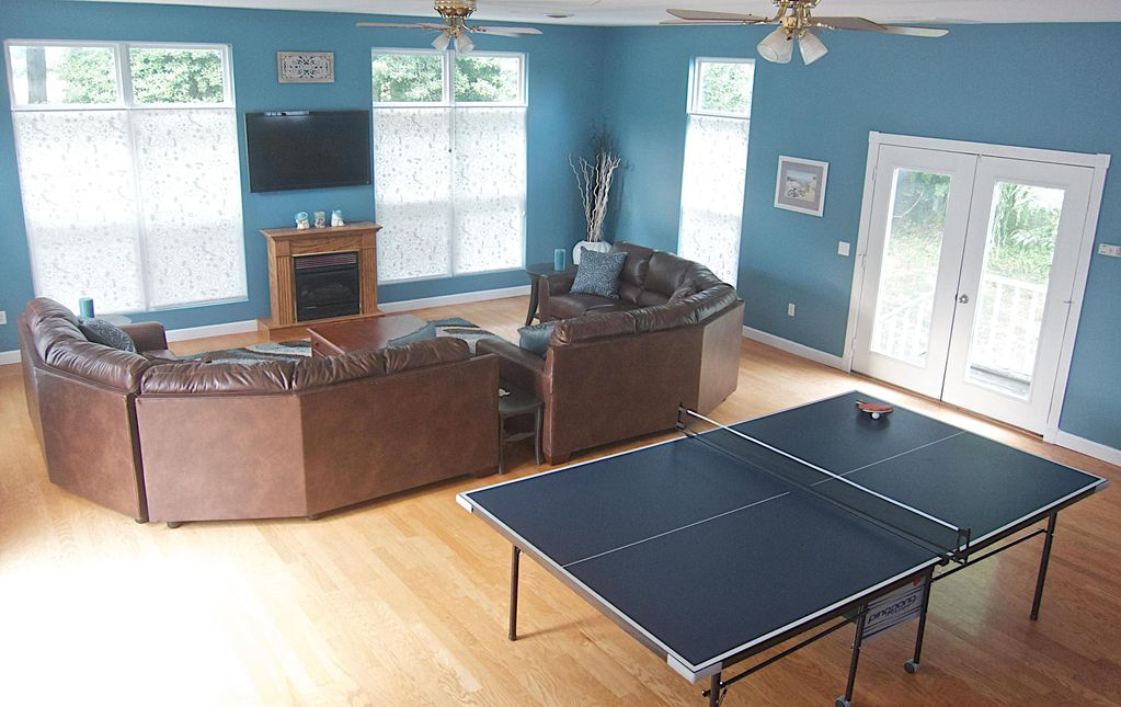 north wing family room have a movie marathon or family ping pong tournament