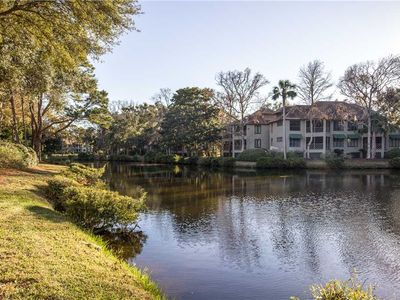 Photo for Just a Short Walk to the Beach, Relax on the Screened Porch Looking Out Over the Tranquil Lagoon!
