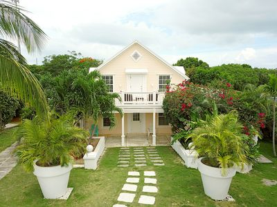 Peach House on lush landscaped grounds a short walk from town and the beach.   This unit, Peach House Upstairs, is a private apartment that takes up the entire second floor.