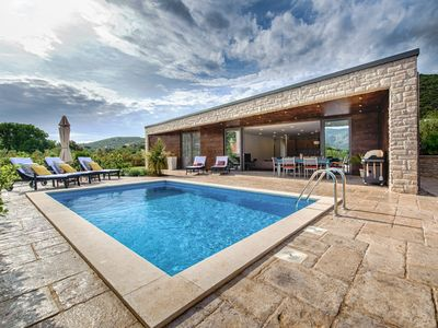 Photo for Holidays for the soul in the new and modern bungalow with pool and sea view
