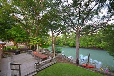 Excellent Riverfront Deck-Kayaks Not Included - Includes spacious outdoor dining table, great views, and new string lighting
