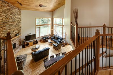 Great room with 25 foot vaulted ceilings and gas fireplace