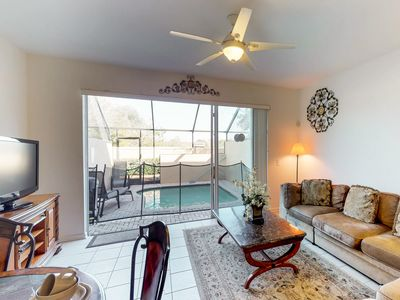 Photo for Family-friendly townhome w/private pool & shared hot tub - close to theme parks!
