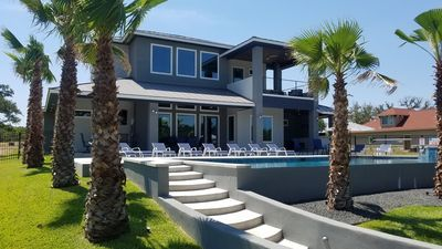 Photo for Newly built, Waterfront vacation rental, sleeps 30, Resort style pool/hot tub