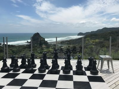 Photo for Stunning Piha Views, large decks, Modern and sun drenched house.