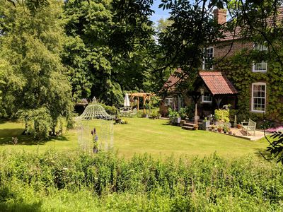 Photo for A charming riverside country cottage in pretty gardens near Langrick, Boston.